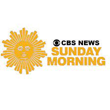 """The logo for CBS Sunday Morning which has a yellow sun of the left with black text that reads """"CBS News"""" and yellow text that reads """"Sunday Morning"""""""